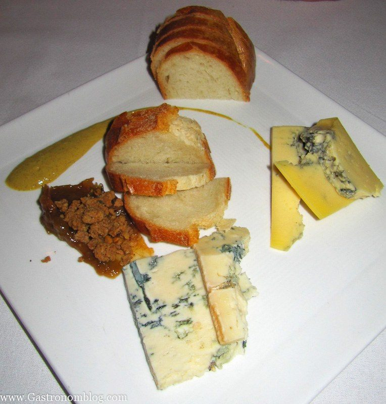 Cheeses and bread on white plate at V Mertz Restaurant Omaha