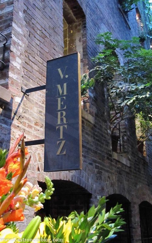 V Mertz Restaurant Omaha sign on brick wall in Omaha Old Market Passageway