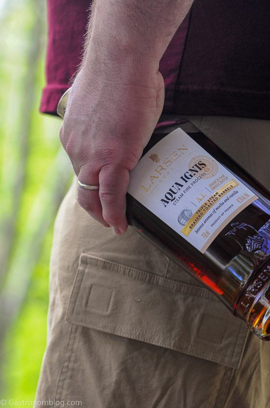 Hand holding cognac bottle